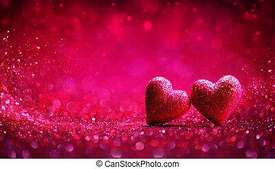 Dos corazones rojos de fondo brillante. Día de San Valentín