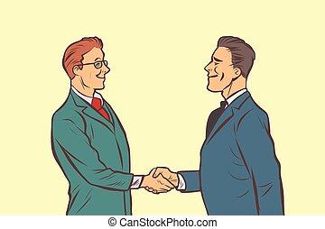 Dos hombres de negocios estrechando la mano. Apretón de manos