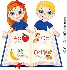Dos niños y un libro de ABC