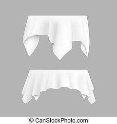 Dos rondas blancas con mantel
