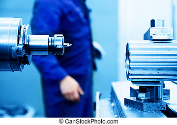Drilling y máquina aburrida en el trabajo. Industria, industrial