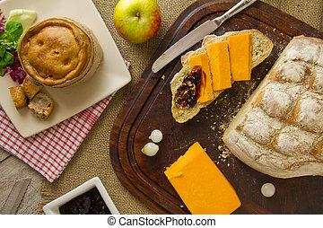 El almuerzo de Ploughman se extiende desde arriba con pan cortado