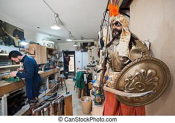 El artesano de marioneta siciliana