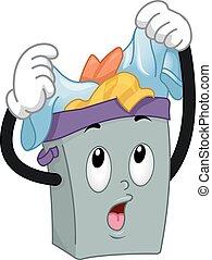 El cesto de la mascota sobrecargada de ropa