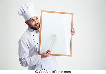 El chef feliz cocina en blanco