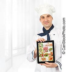 El cocinero muestra una tableta digital con menú