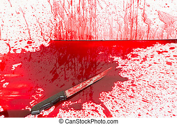 El concepto de Halloween: cuchillo sangriento con salpicaduras de sangre