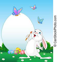 El conejito de Pascua pintando huevos de Pascua