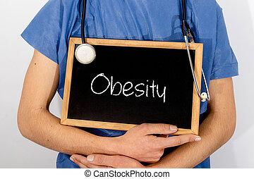 El doctor muestra información en la pizarra: obesidad. Un concepto médico.
