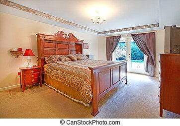El dormitorio principal con cama grande