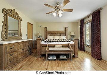 El dormitorio principal con muebles de roble