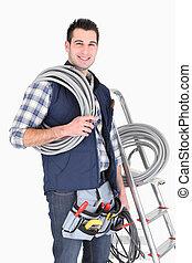 El electricista en el trabajo de cole