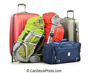 El equipaje consiste en maletas grandes mochilas y bolso de viaje