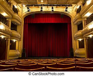 El escenario del teatro y la cortina roja