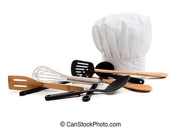 El gorro de Chef con varios utensilios de cocina en blanco