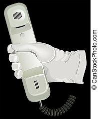 El guante blanco sostiene el teléfono