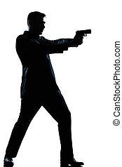 El hombre de la silueta dispara con arma