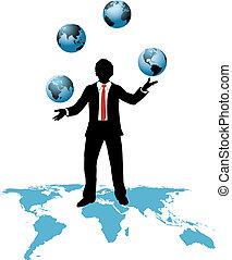 El hombre de negocios mundial hace malabares con los mundos de los negocios