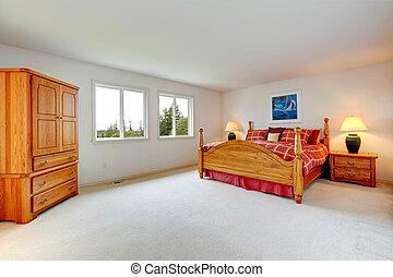 El interior del dormitorio principal con muebles de madera
