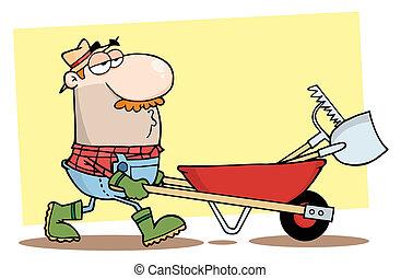 El jardinero maneja una carretilla con herramientas