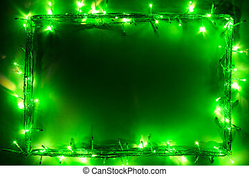 El marco de Navidad de luces verdes