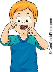 El niño usa hilo dental para ilustrar los dientes