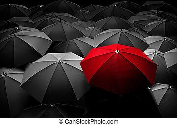 El paraguas rojo se destaca entre la multitud. Diferente, líder.