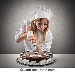 El pastelero prepara un pastel