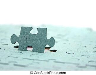 El rompecabezas se concentra en una pieza vertical superficial