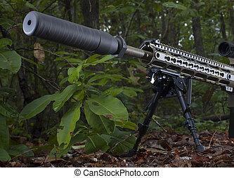 El silenciador del rifle