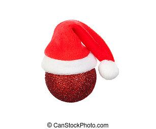 El sombrero de Santa en una bola de Navidad roja