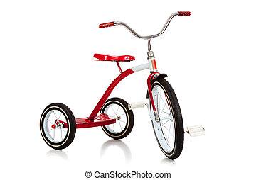 El triciclo rojo del niño sobre blanco