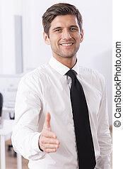Elegante hombre de negocios listo para el apretón de manos