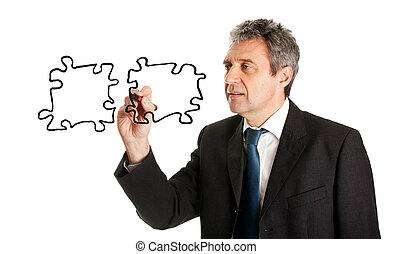 Empresario dibujando piezas de rompecabezas