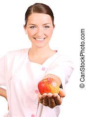enfermera, manzana, ofrecimiento
