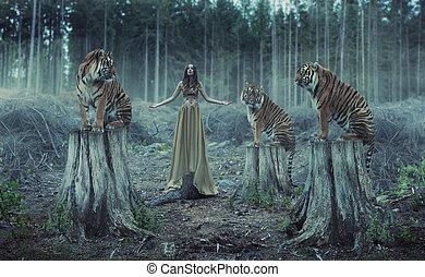 Entrenadora atractiva con tigres