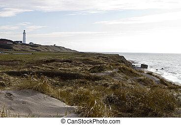 Escena costera del norte con faro