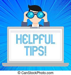 Escribiendo notas que muestran consejos útiles. La foto de negocios muestra información secreta o consejo dado para ser útil el hombre que sostiene y mira en Binocular detrás de la pantalla portátil.