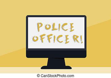 Escribiendo un texto oficial de policía. Un concepto de negocios para una manifestación que es un oficial del equipo de la policía en blanco escritorio espacial con pantalla colorida de monitor en la mesa.
