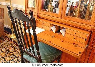 Escribir escritorio y silla