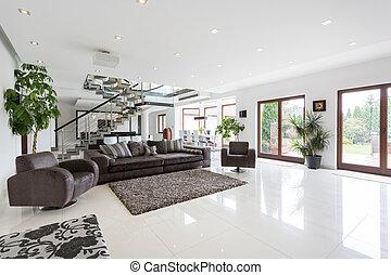 Espacio sala de estar con escaleras