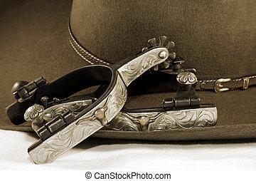 Espuelas de plata y sombrero de vaquero