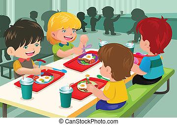 Estudiantes de primaria comiendo en la cafetería