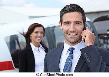 exitoso, hombre de negocios, aeropuerto