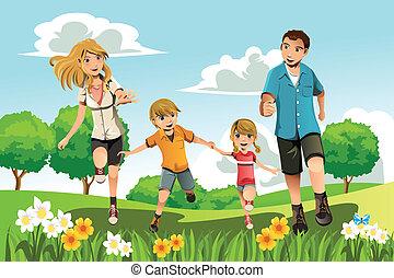 Familia corriendo en parque