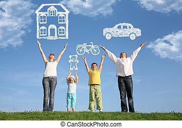 Familia de cuatro en la hierba con manos arriba y sueños, collage