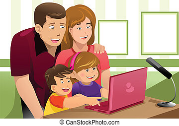 Familia feliz mirando una laptop