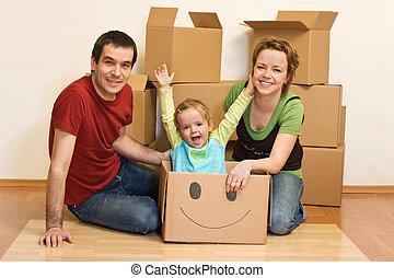 familia , piso, sentado, su, nuevo hogar, feliz