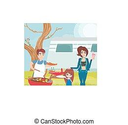 Familia teniendo un picnic