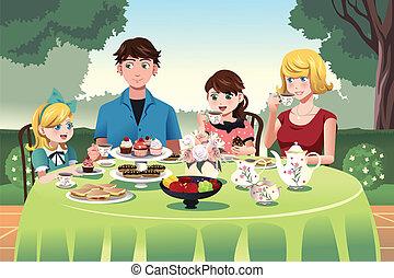 Familia teniendo una fiesta de té juntos
